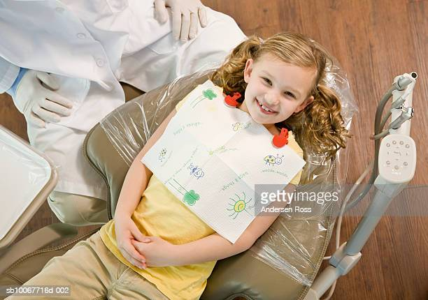 Girl (6-7) with dentist, elevated view