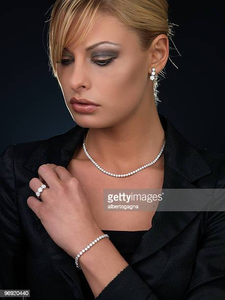 girl with diamonds - diamond necklace stock pictures, royalty-free photos & images
