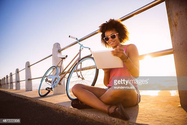 Girl with digital tablet near beach