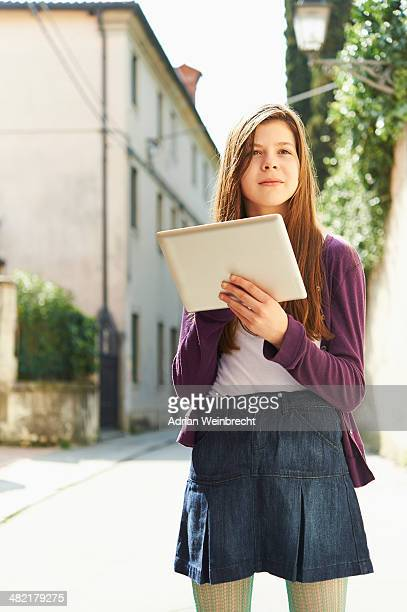 Girl with digital tablet on street, Province of Venice, Italy