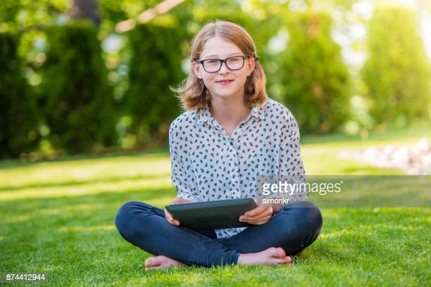 girl with digital tablet - 13 years old girl in jeans stock photos and pictures