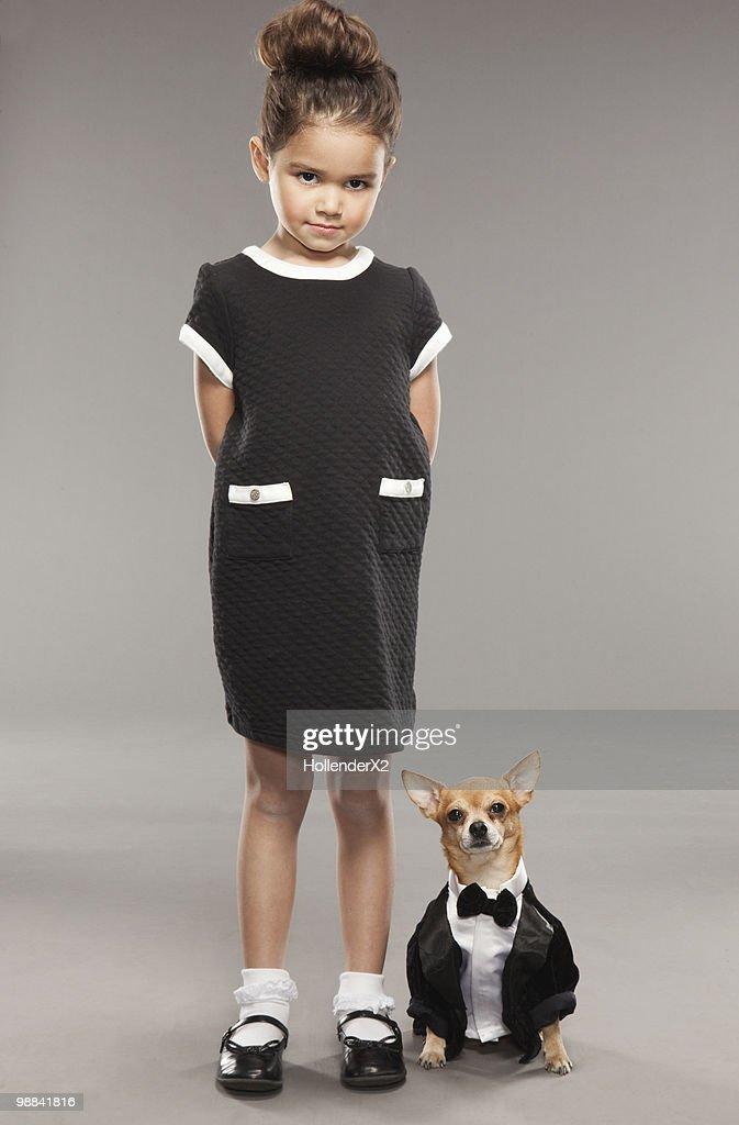 Girl with dog - dressed alike : Stock Photo
