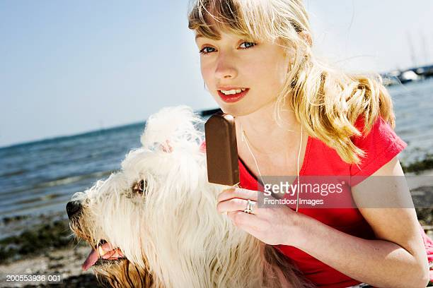 girl (10-11) with dog, eating ice cream - dog eats out girl stock pictures, royalty-free photos & images