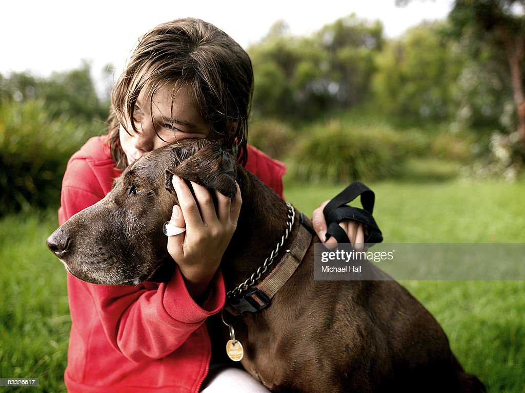 Girl with dog in country field : Stock Photo