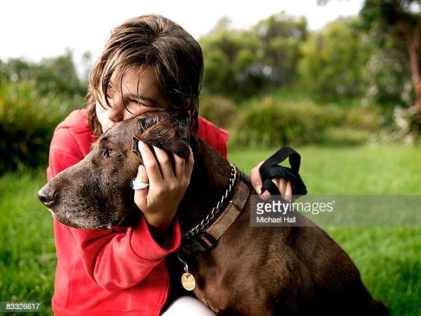 girl with dog in country field - pet equipment stock pictures, royalty-free photos & images