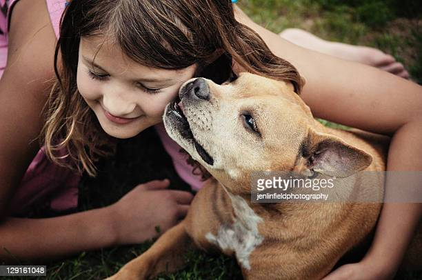 Girl with dog staffordshire bull terrier