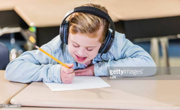 girl with down syndrome in elementary school - learning disability stock pictures, royalty-free photos & images