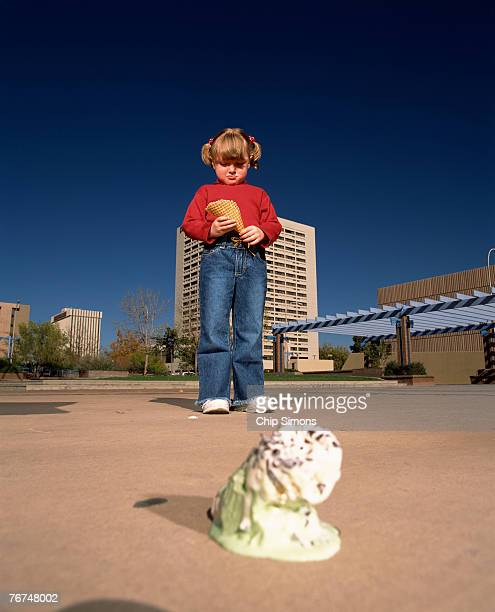Girl with dropped ice cream
