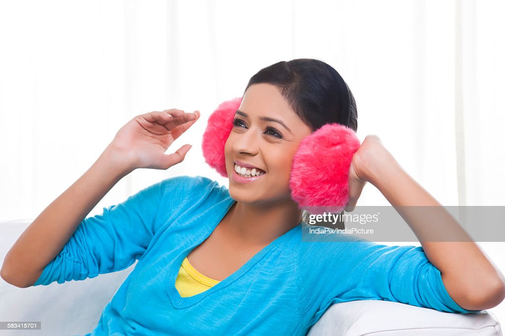 Girl with ear muffs : Stock Photo