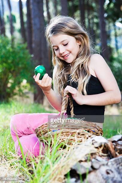 girl with easter basket - osternest stock-fotos und bilder