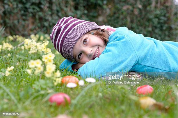 Girl with easter eggs in a spring meadow