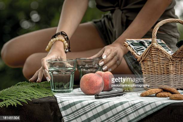 Girl with elegant hands setting up a little picnic