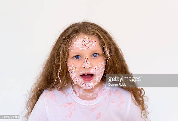 girl with face covered with pink dessert - ugly girl stock photos and pictures