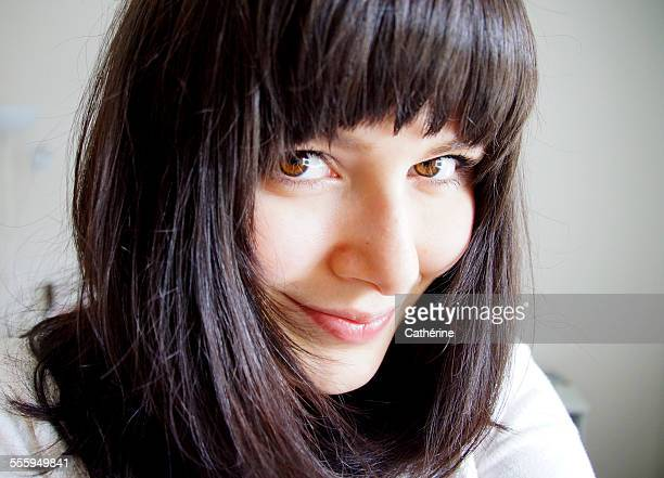 Girl with fair skin and dark hair smiling