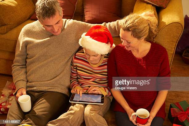 Girl with family using digital tablet at christmas
