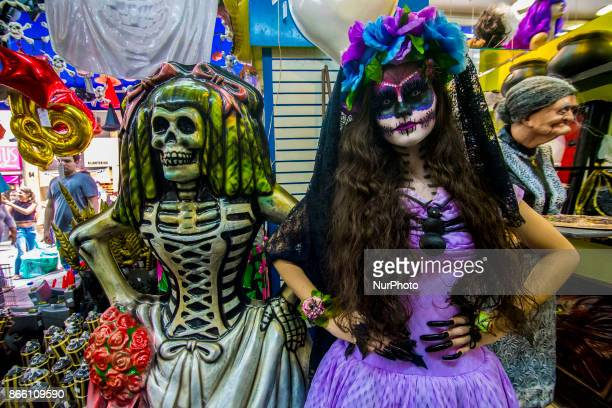 Girl with fantasy and catrina makeup shakes up transeuentes and consumers at Ladeira Porto Geral on 24 October 2017 in Sao Paulo Brazil La Catrina de...