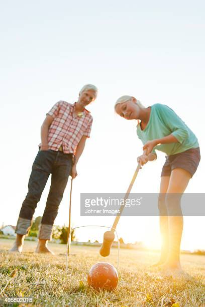Girl with father playing croquet, Skanor, Skane, Sweden