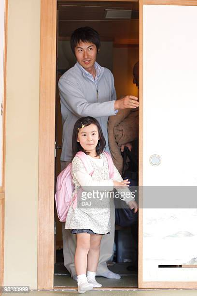 girl with father standing at sliding door, smiling - open backpack stock pictures, royalty-free photos & images