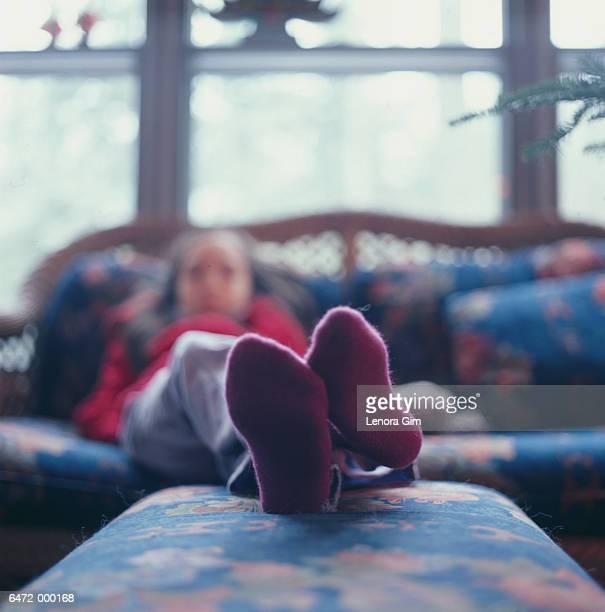 Girl with Feet on Ottoman
