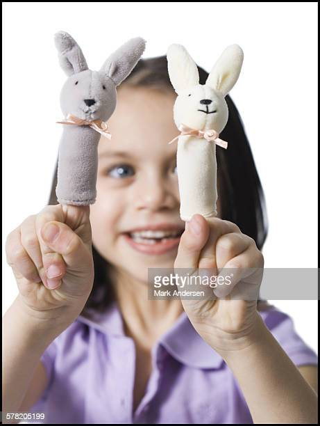 Girl with finger puppets