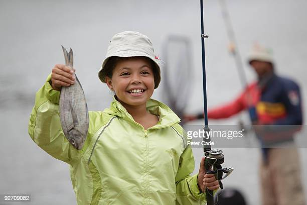 girl with fish caught fishing