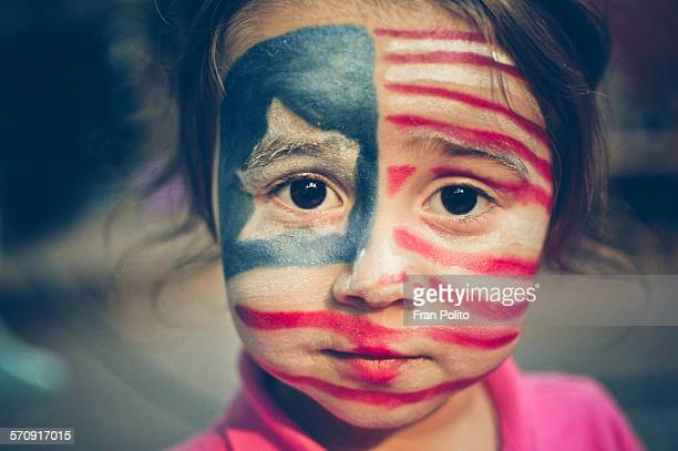 Girl with flag painted on her face