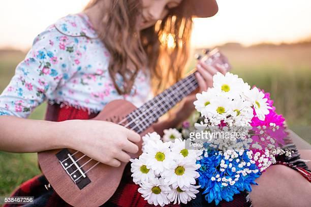 Girl with flowers and ukulele