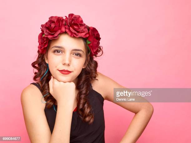 Girl with flowers in hair wearing makeup