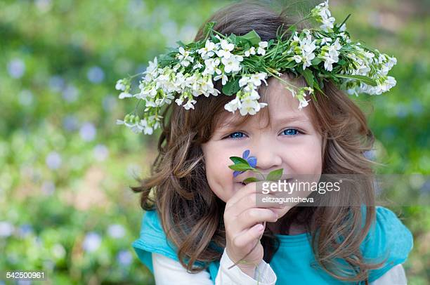 Girl (4-5) with flowers