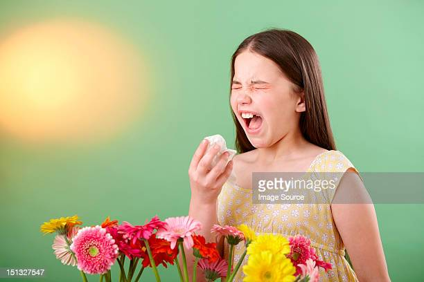 girl with flowers sneezing - espirrando - fotografias e filmes do acervo