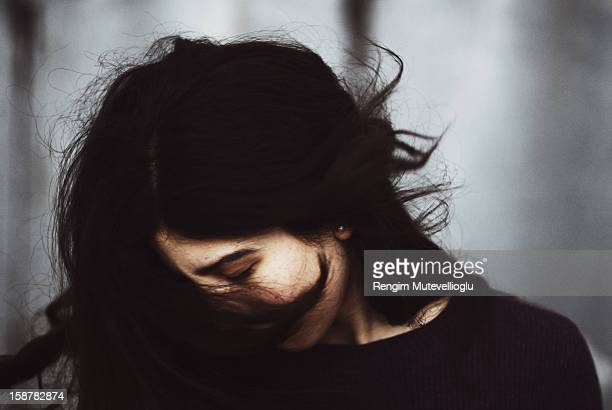 girl with flowing black hair - windswept stock pictures, royalty-free photos & images
