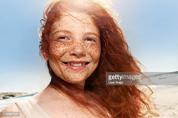 Girl with freckles on face, portrait, close up