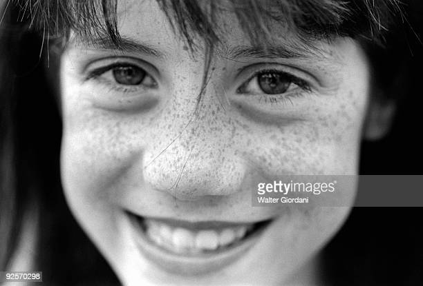 Girl with freckles smiling