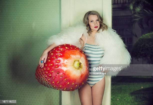 girl with giant srawberry - giantess stock photos and pictures