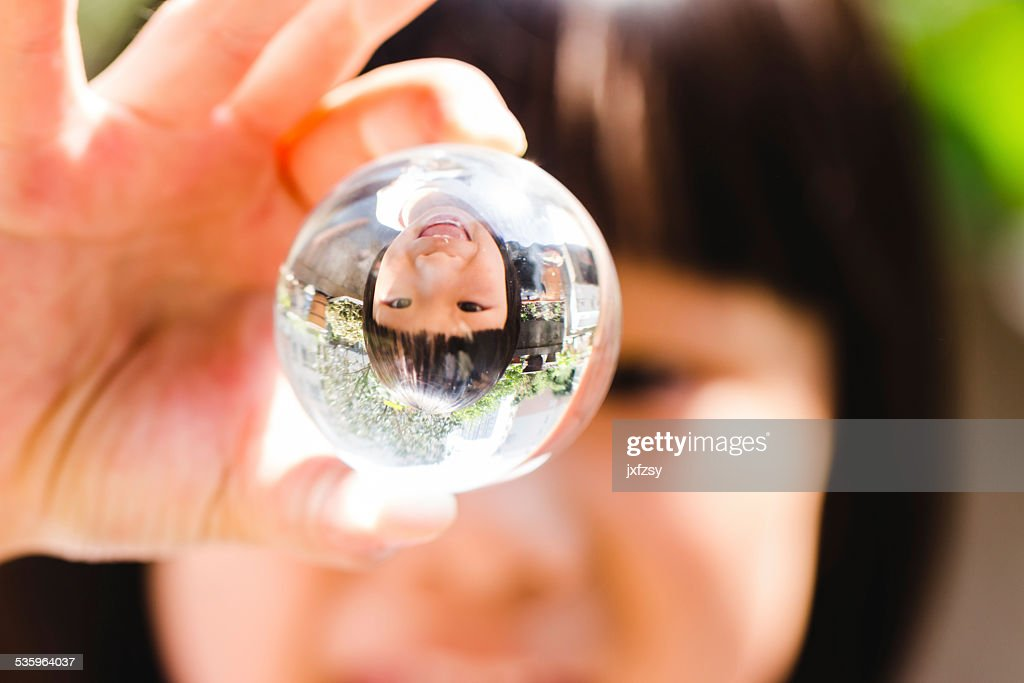 girl with glass ball : Stock Photo
