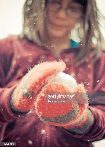 Girl with glasses, making snowball