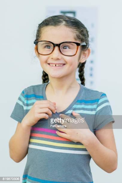 girl with glasses - eye test chart foto e immagini stock