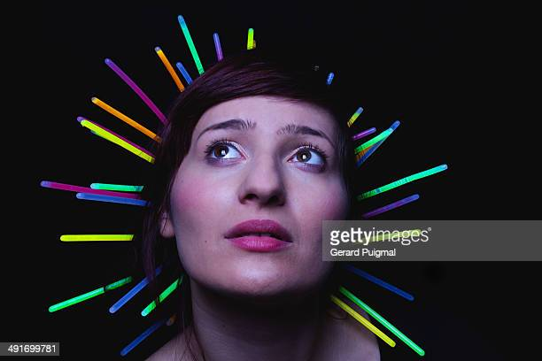 Girl with glow sticks attached on her hair.