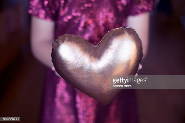 girl with golden heart in hands - organ donation stock photos and pictures