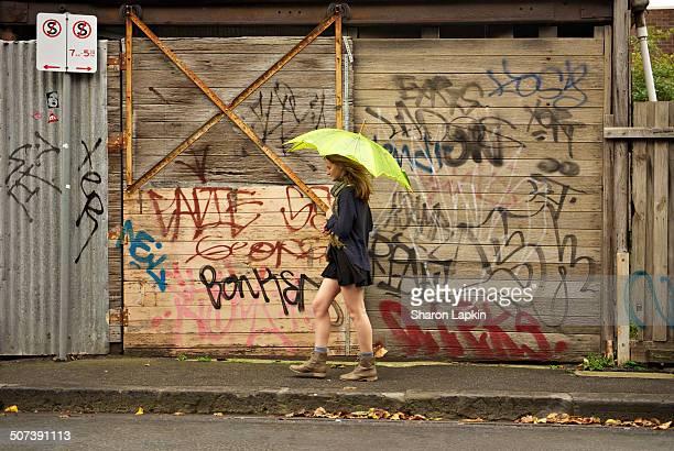 Girl with green umbrella