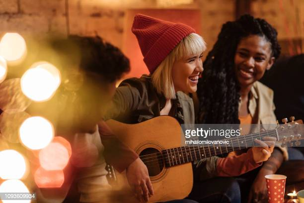 Girl with guitar at the party