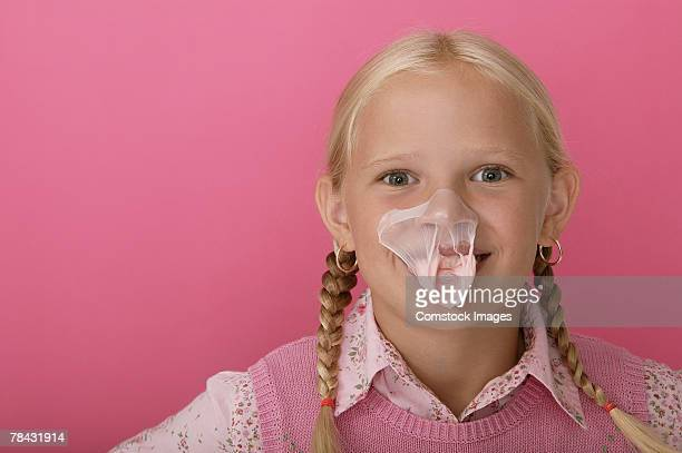 Girl with gum on her face