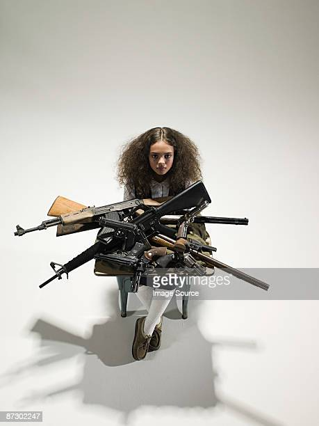 Girl with guns on desk