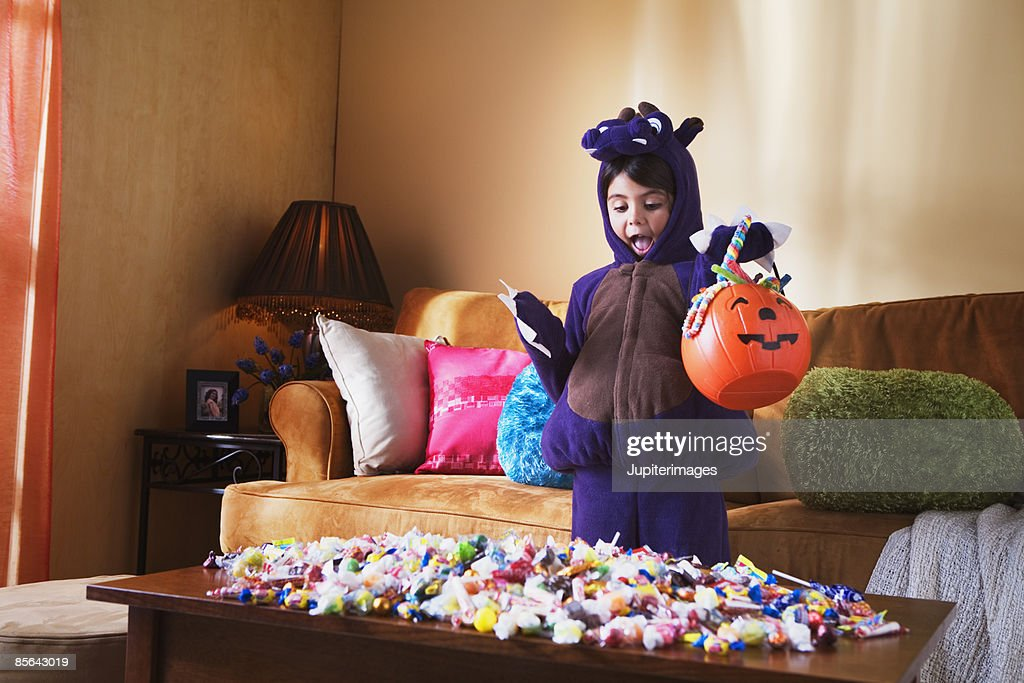 Girl with Halloween candy : Stock Photo