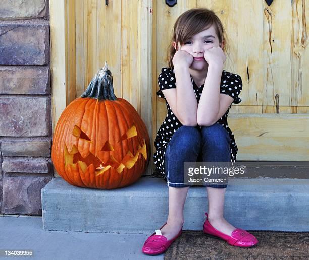 girl with halloween pumpkin - herriman stock pictures, royalty-free photos & images