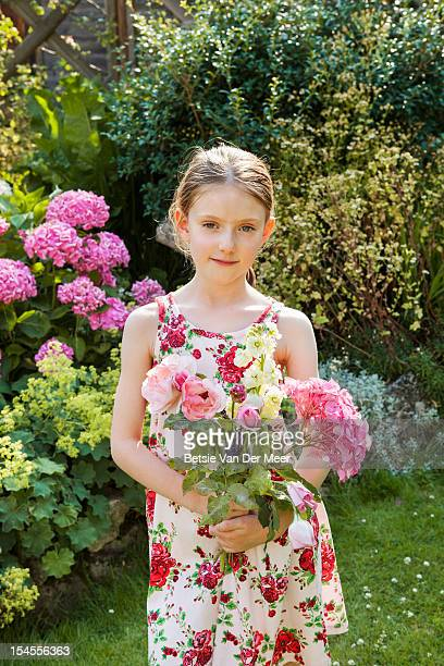 girl with hand picked bouquet of flowers in garden - bunch of flowers stock pictures, royalty-free photos & images