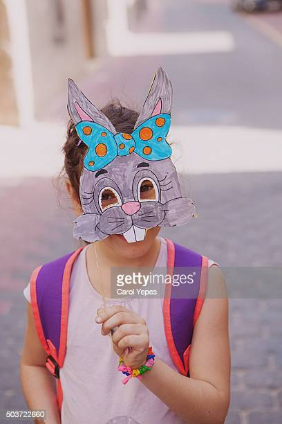 girl with handmade paper bunny mask