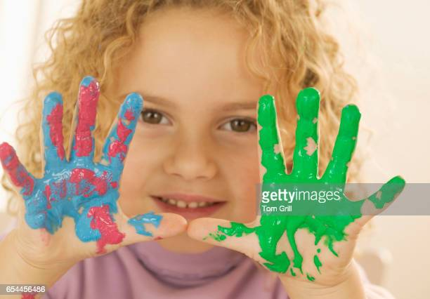 Girl with Hands Covered in Paint