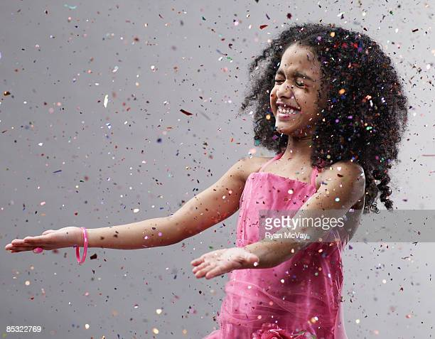 Girl with hands out confetti flying