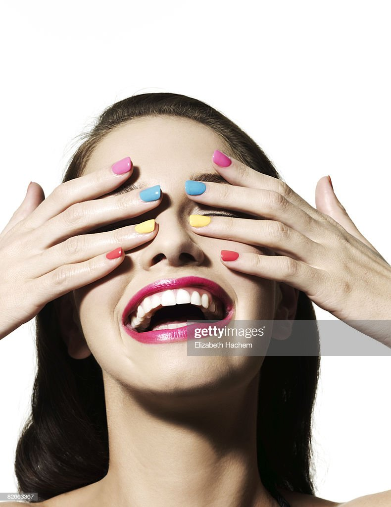 Girl with hands over her eyes : Stock Photo